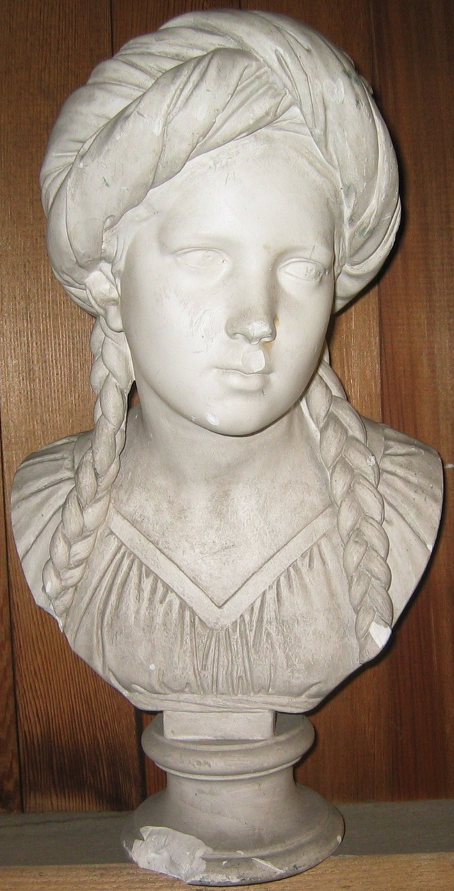 Borstbeeld van een meisje met vlechten en tulband