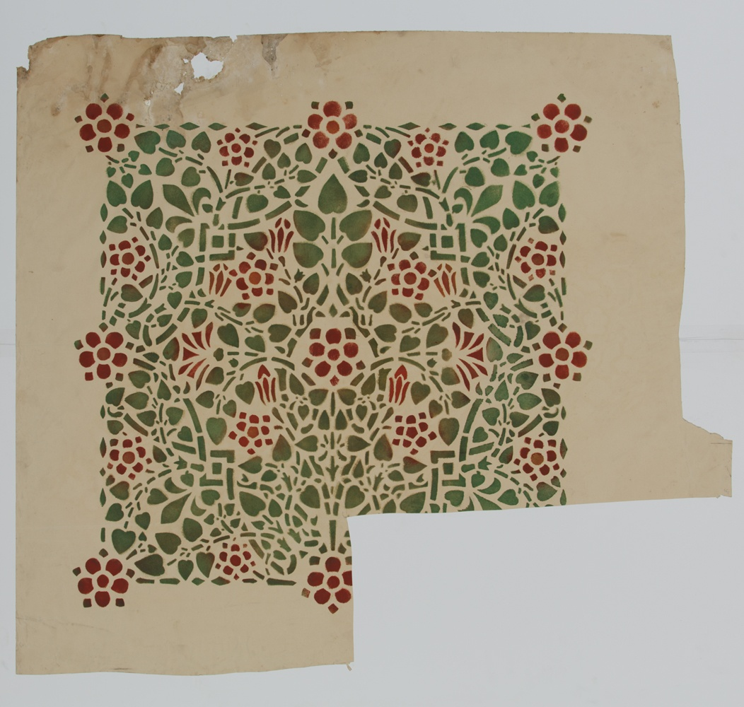 Proefdruk van een sjabloon, met groene blaadjes en rode bloemen.